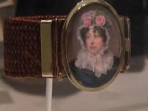 A mourning brooch, a miniature of the deceased with a cuff woven of her hair.